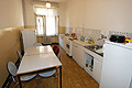 Kitchen with fridge in Prague Hostel Budec